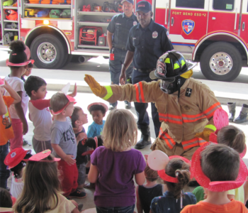 Fire Fighter Giving a High Five